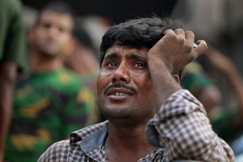 Description of . A Bangladeshi relative of a victim cries at the site of a building that collapsed Wednesday in Savar, near Dhaka, Bangladesh,Thursday, April 25, 2013. (AP Photo/A.M.Ahad)
