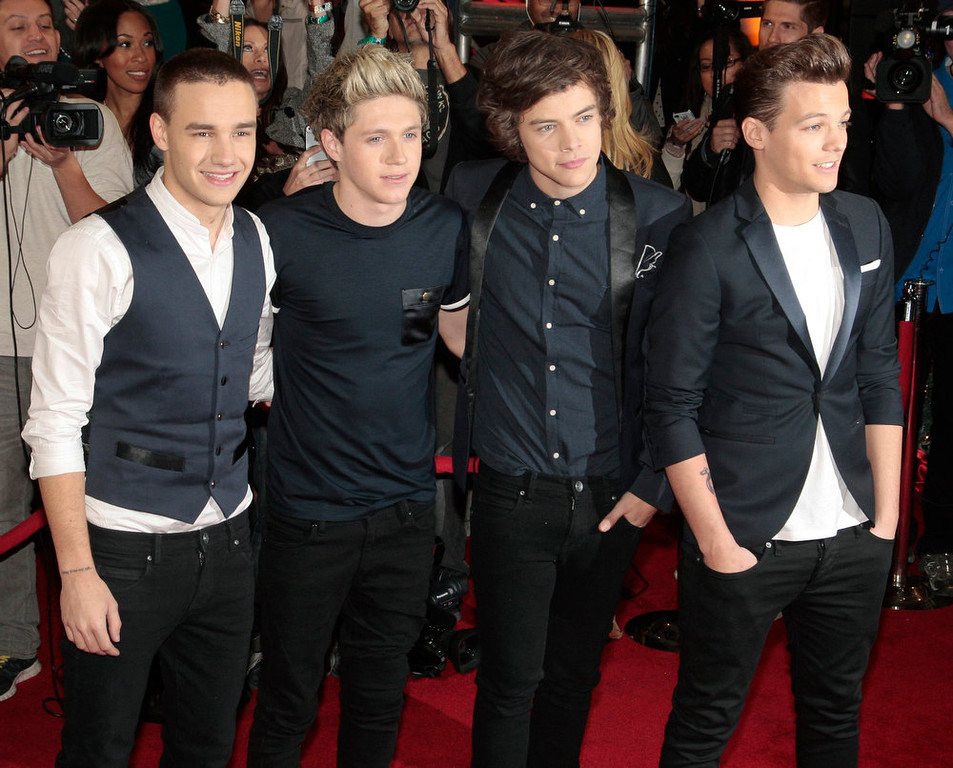 Description of . Members of the band One Direction (L-R), Liam Payne, Niall Horan, Harry Styles and Louis Tomlinson, arrive for Fox's