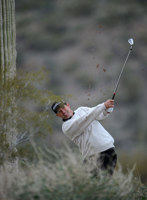 Description of . MARANA, AZ - FEBRUARY 21: Padraig Harrington of Ireland plays a shot on the 18th hole during the first round of the World Golf Championships - Accenture Match Play at the Golf Club at Dove Mountain on February 21, 2013 in Marana, Arizona. Round one play was suspended on February 20 due to inclimate weather and is scheduled to be continued today.  (Photo by Stuart Franklin/Getty Images)
