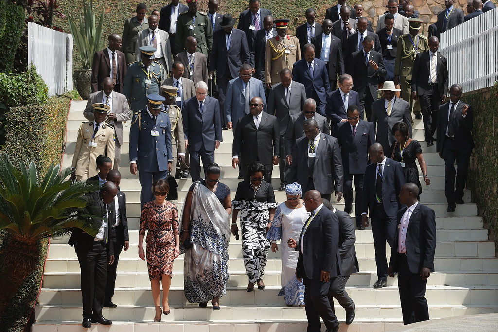 Description of . Global leaders, past and present, arrive for a commemoration ceremony at the Kigali Genocide Memorial Center on April 7, 2014 in Kigali, Rwanda.  (Photo by Chip Somodevilla/Getty Images)
