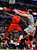 Chicago Bulls' Nate Robinson (2) shoots against Houston Rockets' Omer Asik in the fourth quarter of an NBA basketball game in Chicago, Tuesday, Dec. 25, 2012. Houston won 120-97. (AP Photo/Paul Beaty)