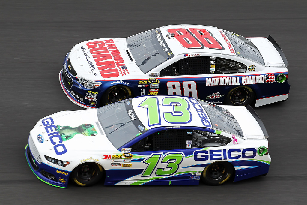 Description of . Casey Mears, driver of the #13 GEICO Toyota, and Dale Earnhardt Jr., driver of the #88 National Guard Chevrolet, race  during the NASCAR Sprint Cup Series Daytona 500 at Daytona International Speedway on February 24, 2013 in Daytona Beach, Florida.  (Photo by Todd Warshaw/Getty Images)