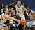 DENVER, CO. - MARCH 5: Cougars guard Kyle Weaver, center, tried to get past Roadrunner's defender Mitch McCarron, left, in the first half. The Metro State University of Denver men's basketball team defeated Colorado Christian University 87-75 Tuesday night, March 5, 2013. (Photo By Karl Gehring/The Denver Post)