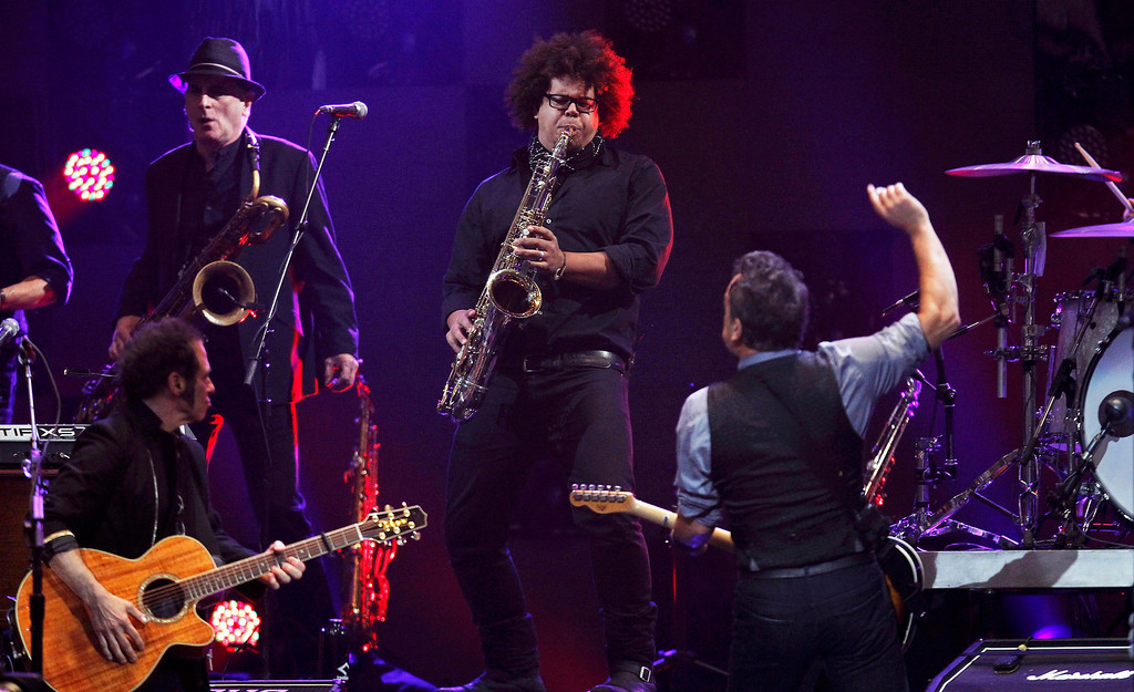 Description of . Singer Bruce Springsteen (R) performs with Nils Lofgren (L) and Jake Clemons (centre), nephew of the late Clarence Clemons, during the