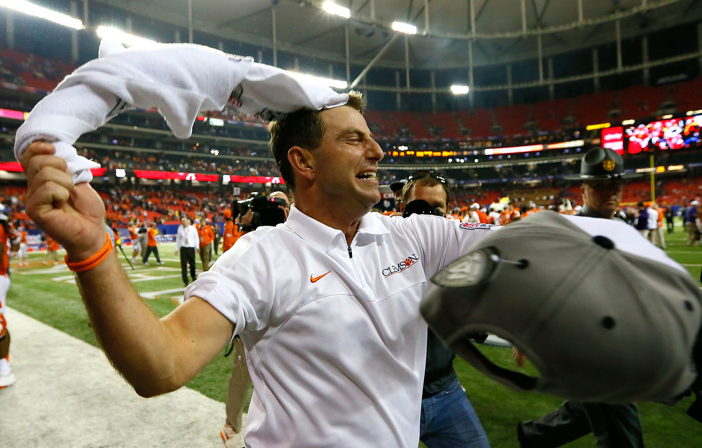 Description of . ATLANTA, GA - JANUARY 01:  Head coach Dabo Swinney of the Clemson Tigers celebrates their 25-24 win over the LSU Tigers during the 2012 Chick-fil-A Bowl at Georgia Dome on December 31, 2012 in Atlanta, Georgia.  (Photo by Kevin C. Cox/Getty Images)