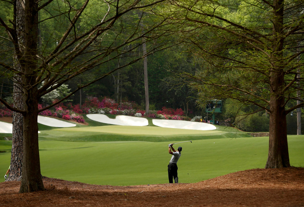 Description of . Tiger Woods of the U.S. hits his approach shot to the 13th green during first round play in the 2013 Masters golf tournament at the Augusta National Golf Club in Augusta, Georgia, April 11, 2013.   REUTERS/Mark Blinch