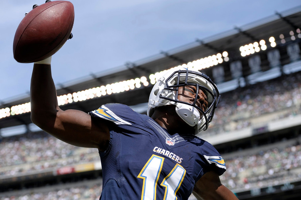 Description of . San Diego Chargers' Eddie Royal celebrates after scoring a touchdown during the first half of an NFL football game against the Philadelphia Eagles, Sunday, Sept. 15, 2013, in Philadelphia. (AP Photo/Michael Perez)