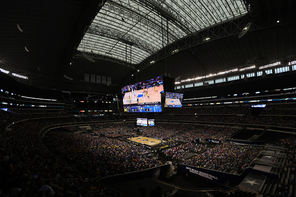 Description of . Cowboys Stadium is seen during the first half of a regional semifinal game between Kansas and Michigan in the NCAA college basketball tournament, Friday, March 29, 2013, in Arlington, Texas. (AP Photo/Tim Donnelly)