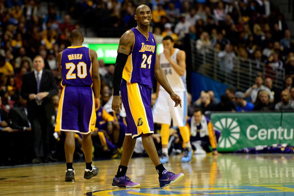 Description of . Los Angeles Lakers shooting guard Kobe Bryant (24) reacts to a foul call during the second half of the Nuggets' 126-114 win at the Pepsi Center on Wednesday, December 26, 2012. AAron Ontiveroz, The Denver Post