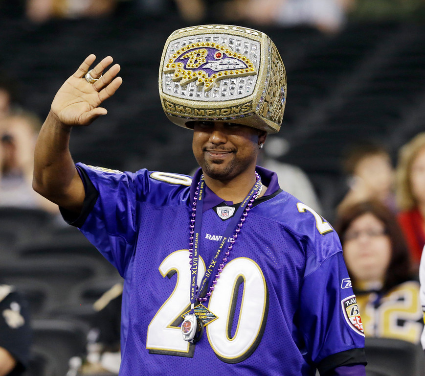 Description of . Baltimore Ravens fan Uland Price from Baton Rouge, La., waves during media day for the NFL Super Bowl XLVII football game Tuesday, Jan. 29, 2013, in New Orleans. (AP Photo/Pat Semansky)
