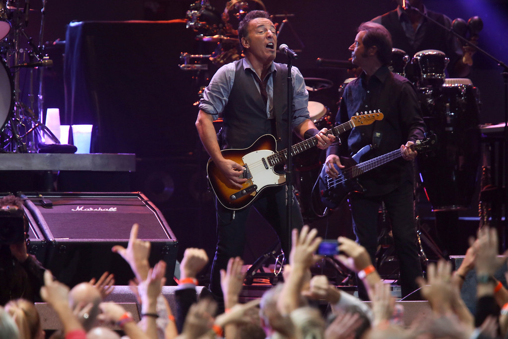 Description of . Bruce Springsteen performs at the 12-12-12 benefit concert for victims of Hurricane Sandy, at Madison Square Garden in New York, Dec. 12, 2012. The concert features a lineup spanning five decades of music. (Damon Winter/The New York Times)