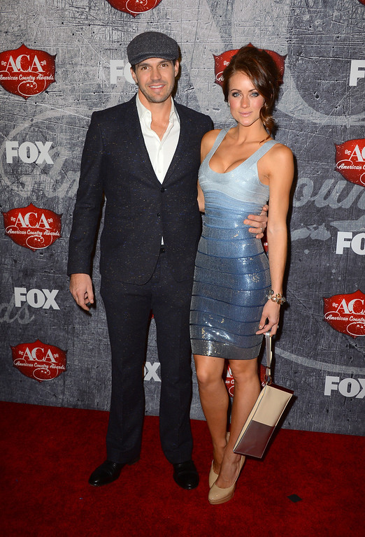 Description of . LAS VEGAS, NV - DECEMBER 10:  Major League Baseball pitcher Barry Zito (L) and his wife Amber Seyer arrive at the 2012 American Country Awards at the Mandalay Bay Events Center on December 10, 2012 in Las Vegas, Nevada.  (Photo by Frazer Harrison/Getty Images)