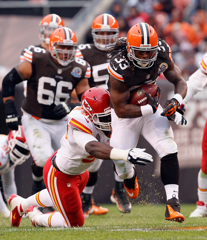 Description of . CLEVELAND, OH - DECEMBER 09:  Running back Trent Richardson #33 of the Cleveland Browns runs the ball by linebacker Justin Houston #50 of the Kansas City Chiefs at Cleveland Browns Stadium on December 9, 2012 in Cleveland, Ohio.  (Photo by Matt Sullivan/Getty Images)