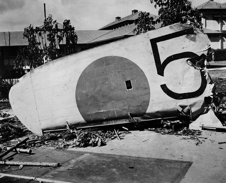 Description of . The wing of a Japanese bomber shot down on the grounds of the Naval Hospital at Honolulu, Hawaii, Dec. 7, 1941. (AP Photo)