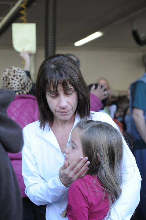 Description of . A mother comforts her daughter near Sandy Hook Elementary School in Newtown, CT. Laurie Gaboardi/Litchfield County Times