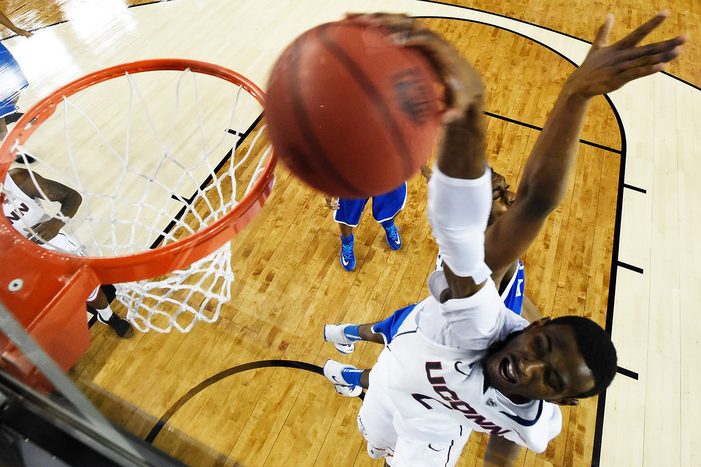Description of . ARLINGTON, TX - APRIL 07: DeAndre Daniels #2 of the Connecticut Huskies dunks against the Kentucky Wildcats during the NCAA Men\'s Final Four Championship at AT&T Stadium on April 7, 2014 in Arlington, Texas. (Photo by Chris Steppig-Pool/Getty Images)