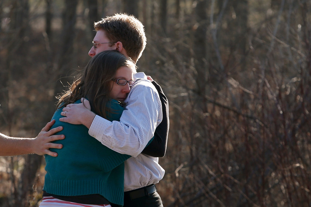 Description of . Family members embrace each other outside Sandy Hook Elementary School after a shooting in Newtown, Connecticut, December 14, 2012. At least 27 people, including children, were killed on Friday when at least one shooter opened fire at an elementary school in Newtown, Connecticut, CBS News reported, citing unnamed officials.    REUTERS/Adrees Latif