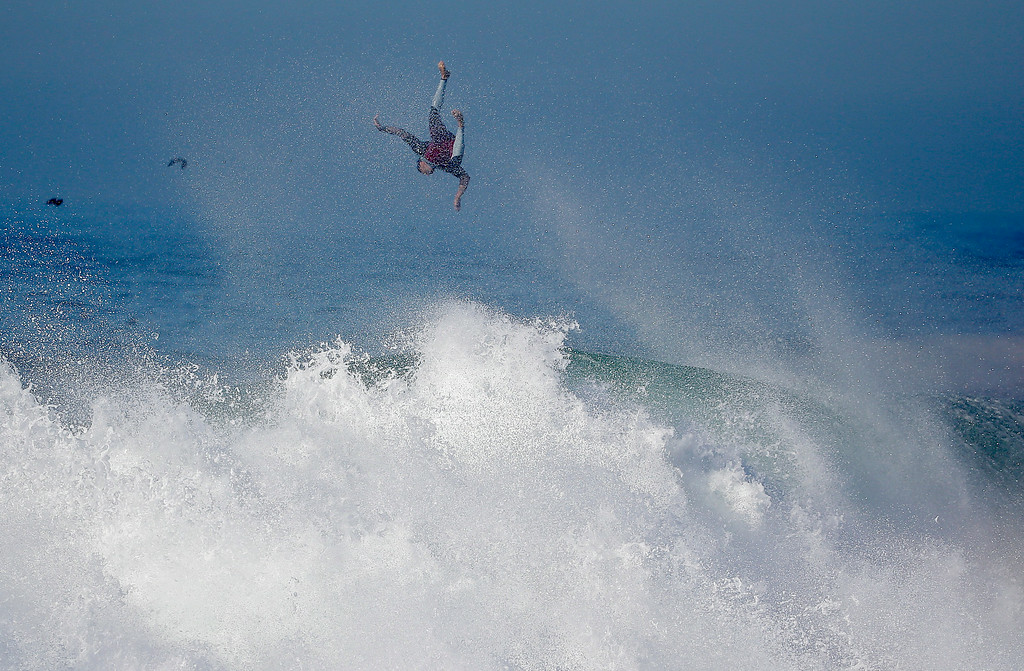 Description of . A surfer flies off a wave at the wedge in Newport Beach, Calif., Wednesday, Aug. 27, 2014. Southern California beachgoers experienced much higher than normal surf, brought on by Hurricane Marie spinning off the coast of Mexico. (AP Photo/Chris Carlson)