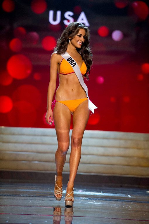 Description of . Miss USA Olivia Culpo competes in her Kooey Australia swimwear and Chinese Laundry shoes during the Swimsuit Competition of the 2012 Miss Universe Presentation Show at PH Live in Las Vegas, Nevada December 13, 2012. The 89 Miss Universe Contestants will compete for the Diamond Nexus Crown on December 19, 2012. REUTERS/Darren Decker/Miss Universe Organization/Handout