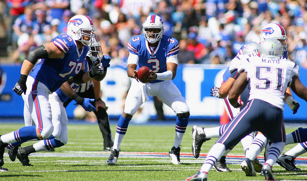 Description of . EJ Manuel #3 of the Buffalo Bills fakes a handoff against the New England Patriots at Ralph Wilson Stadium on September 8, 2013 in Orchard Park, New York.  (Photo by Rick Stewart/Getty Images)