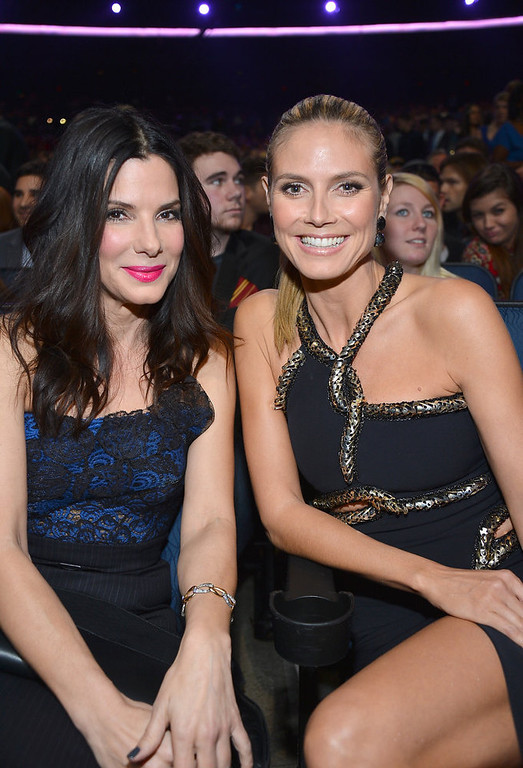 Description of . Actress Sandra Bullock (L) and Heidi Klum attend the 39th Annual People's Choice Awards at Nokia Theatre L.A. Live on January 9, 2013 in Los Angeles, California.  (Photo by Frazer Harrison/Getty Images for PCA)