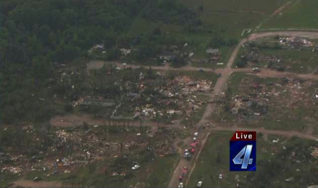 Description of . An aerial view of the damage in the aftermath of tornadoes that touched down near Shawnee Twin Lakes, Oklahoma May 19, 2013, in this still image provided by KFOR-TV. A tornado half a mile wide struck near Oklahoma City on Sunday, part of a massive storm front that hammered the central United States. News reports said at least one person had died. Courtesy of KFOR-TV/Handout via Reuters