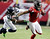 Atlanta Falcons wide receiver Julio Jones (11) tries to get away from Seattle Seahawks' Earl Thomas (29) during the first half of an NFC divisional playoff NFL football game Sunday, Jan. 13, 2013, in Atlanta. (AP Photo/Dave Martin)