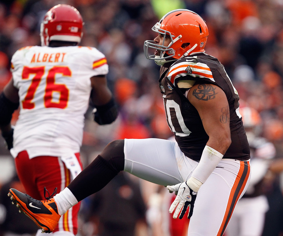 Description of . CLEVELAND, OH - DECEMBER 09: Defensive lineman Billy Winn #90 of the Cleveland Browns celebrates after a sack as tackle Branden Albert #76 of the Kansas City Chiefs at Cleveland Browns Stadium on December 9, 2012 in Cleveland, Ohio.  (Photo by Matt Sullivan/Getty Images)