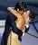 Actor Adrien Brody kisses presenter Actress Halle Berry as he accepts his Oscar for Performance by an actor in a leading role for his role in 