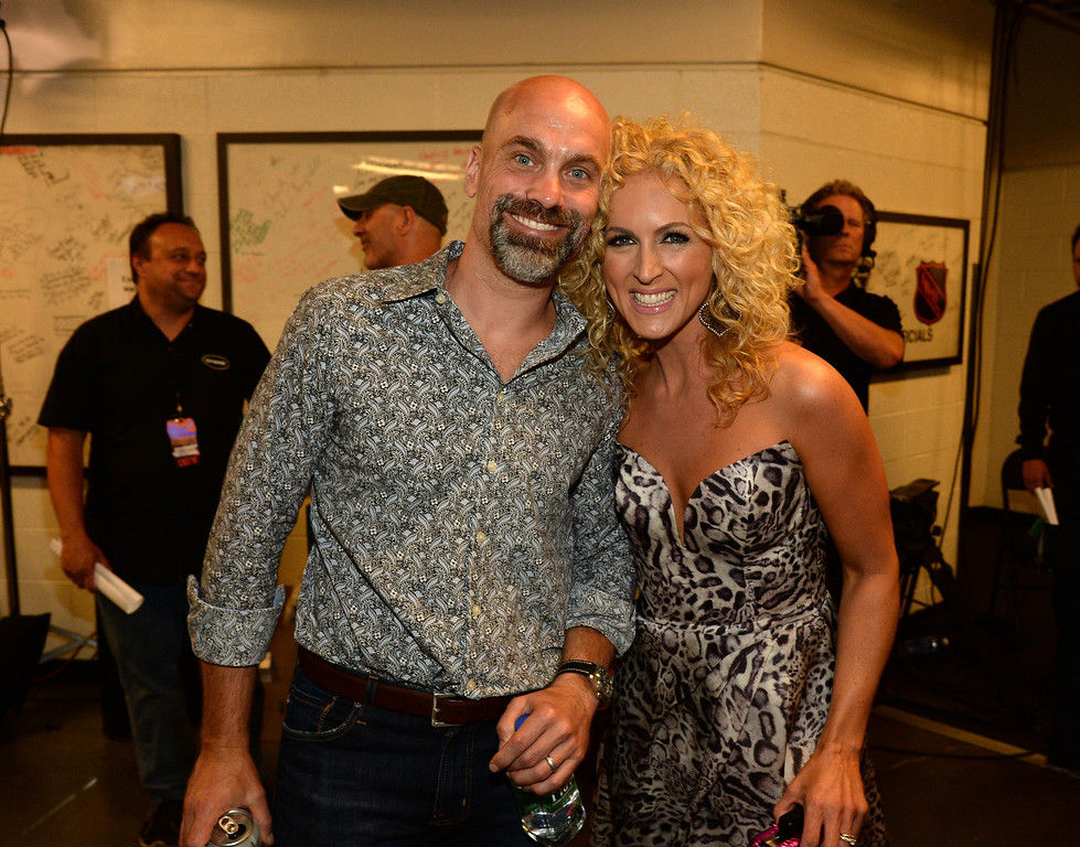 Description of . Kimberly Schlapman (R) of Little Big Town and her husband Stephen Scaplapman attend the 2014 CMT Music Awards at Bridgestone Arena on June 4, 2014 in Nashville, Tennessee.  (Photo by Rick Diamond/Getty Images for CMT)