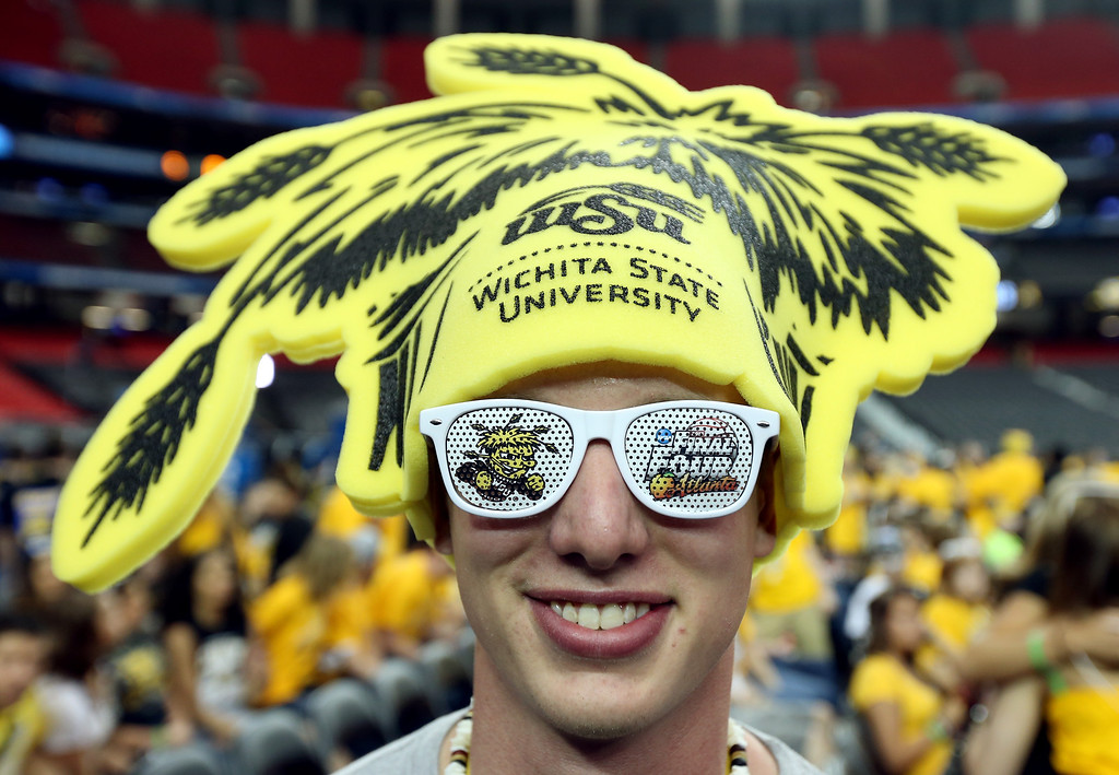 Description of . ATLANTA, GA - APRIL 06:  Tim Eiehler, a Wichita State Shockers fan, poses before the Shockers take on the Louisville Cardinals in the 2013 NCAA Men's Final Four Semifinal at the Georgia Dome on April 6, 2013 in Atlanta, Georgia.  (Photo by Andy Lyons/Getty Images)
