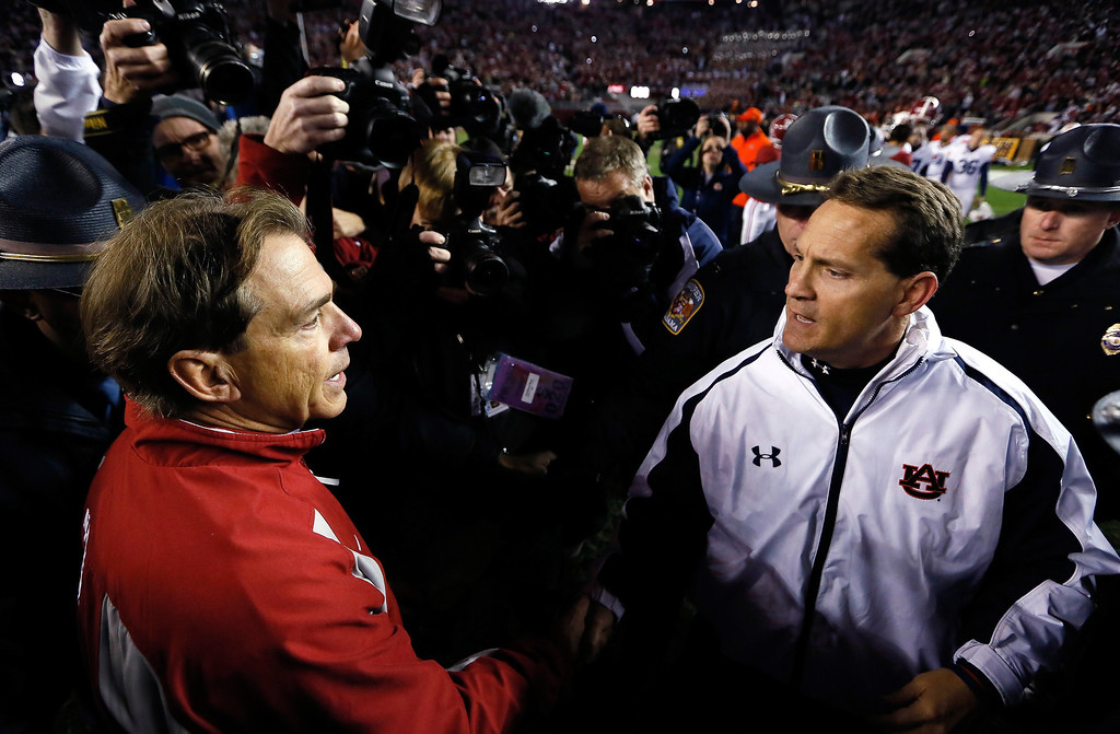 Description of . Head coach Nick Saban of the Alabama Crimson Tide shakes hands with head coach Gene Chizik of the Auburn Tigers after their 49-0 win at Bryant-Denny Stadium on November 24, 2012 in Tuscaloosa, Alabama.  (Photo by Kevin C. Cox/Getty Images)