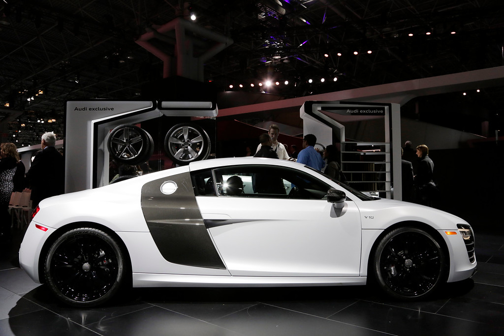 . Members of the media look at the 2015 Audi R8 V10 plus at the New York International Auto Show, Wednesday, April 16, 2014, in New York. (AP Photo/Mark Lennihan)