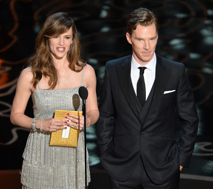 Description of . Actors Jennifer Garner and Benedict Cumberbatch speak onstage during the Oscars at the Dolby Theatre on March 2, 2014 in Hollywood, California.  (Photo by Kevin Winter/Getty Images)