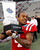 Mississippi linebacker Denzel Nkemdiche (4) holds up the BBVA Compass trophy following the BBVA Compass Bowl NCAA college football game against Pittsburgh at Legion Field in Birmingham, Ala., Saturday, Jan. 5, 2013. Mississippi won 38-17. (AP Photo/Butch Dill)