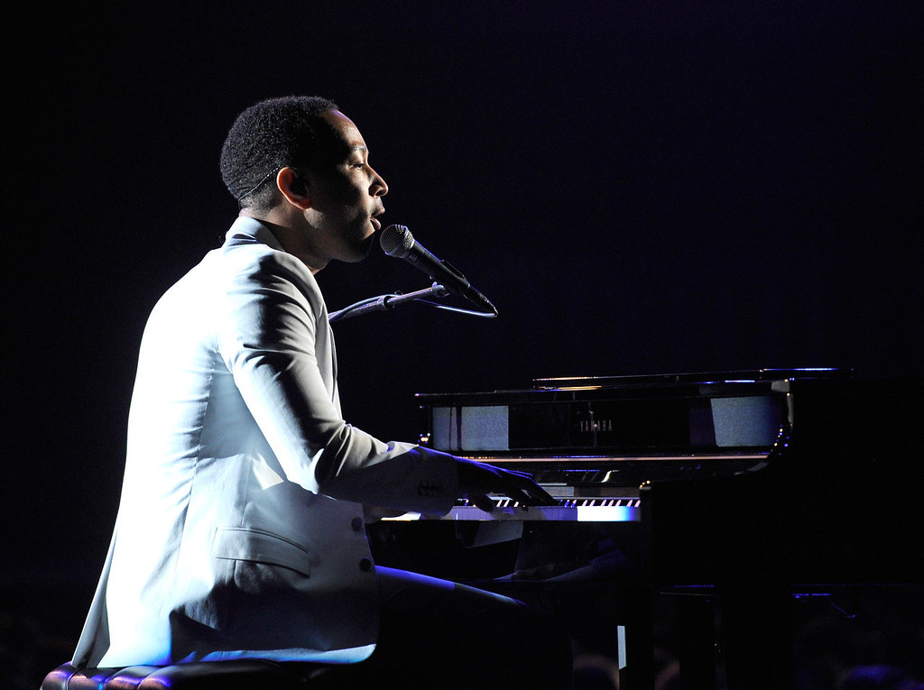 Description of . Musician John Legend performs onstage during the 56th GRAMMY Awards at Staples Center on January 26, 2014 in Los Angeles, California.  (Photo by Kevork Djansezian/Getty Images)
