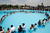 Newlywed couples make a heart's shape in a public swimming pool during a mass wedding on Valentine's Day in Lima February 14, 2013. About 200 couples married in the ceremony organized by a local municipality to commemorate Saint Valentine's Day. REUTERS/Enrique Castro-Mendivil