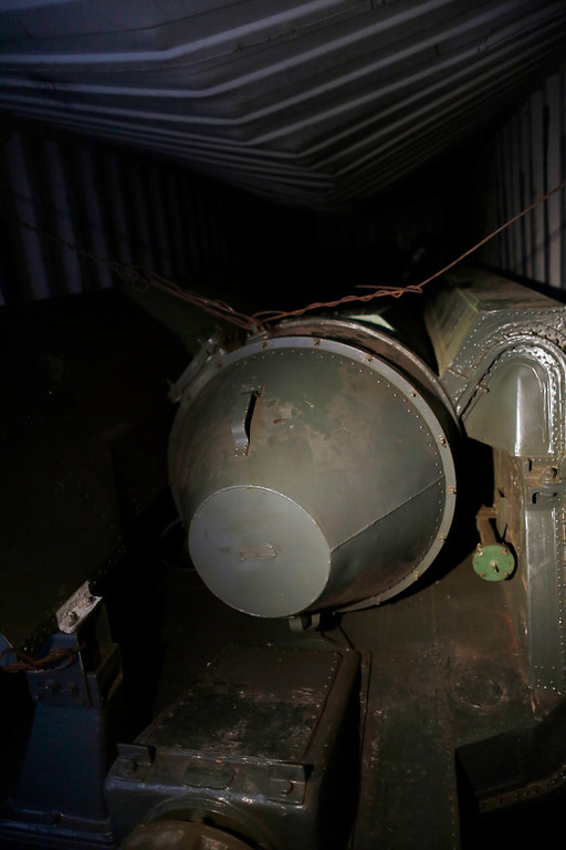Description of . A long, green missile-shaped object is seen inside the North Korean flagged ship