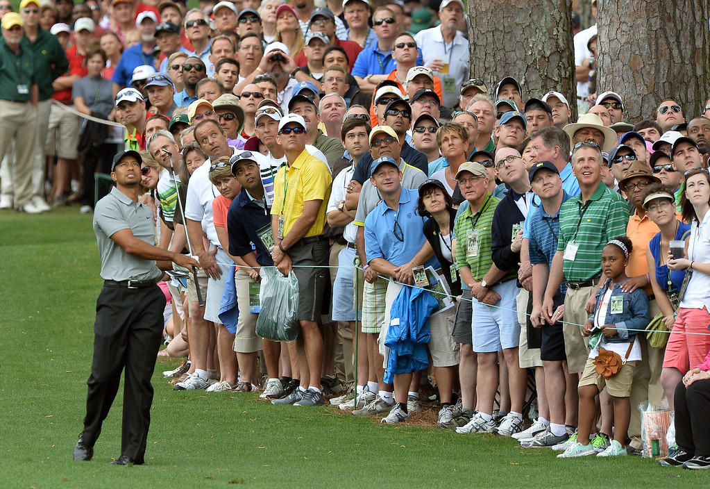 Description of . Tiger Woods of the US plays during the first round of the 77th Masters golf tournament at Augusta National Golf Club on April 11, 2013 in Augusta, Georgia.   JEWEL SAMAD/AFP/Getty Images