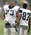 FILE - In this Aug. 1, 2005, file photo, Dallas Cowboys guard Larry Allen (73) shares a laugh with wide reciever Zuriel Smith (87) prior to the start of afternoon practice at NFL football training camp in Oxnard, Calif. Allen was selected to the Pro Football Hall of Fame on Saturday, Feb. 2, 2013. (AP Photo/Tony Gutierrez, File)