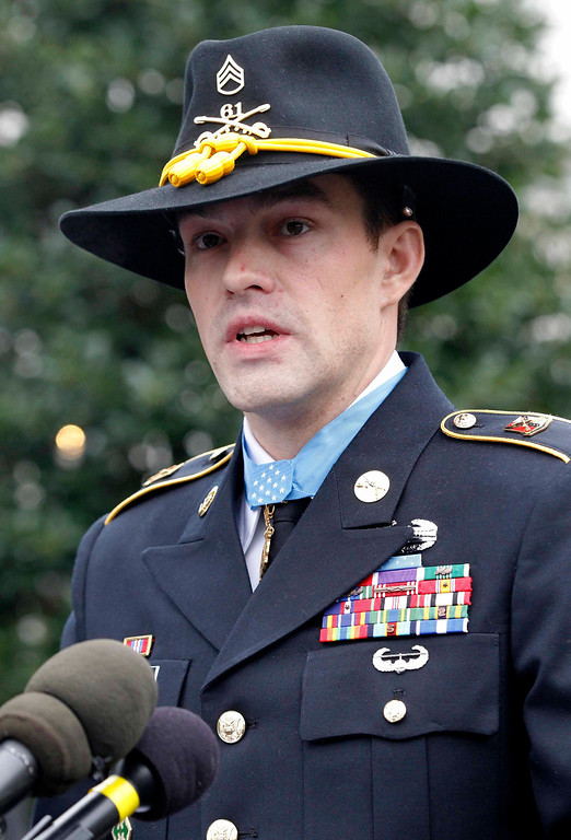 Description of . The Medal of Honor is pictured around the neck of former active duty Army Staff Sergeant Clinton Romesha following a ceremony where he was presented with the medal by U.S. President Barack Obama at the White House in Washington, February 11, 2013.  REUTERS/Jason Reed