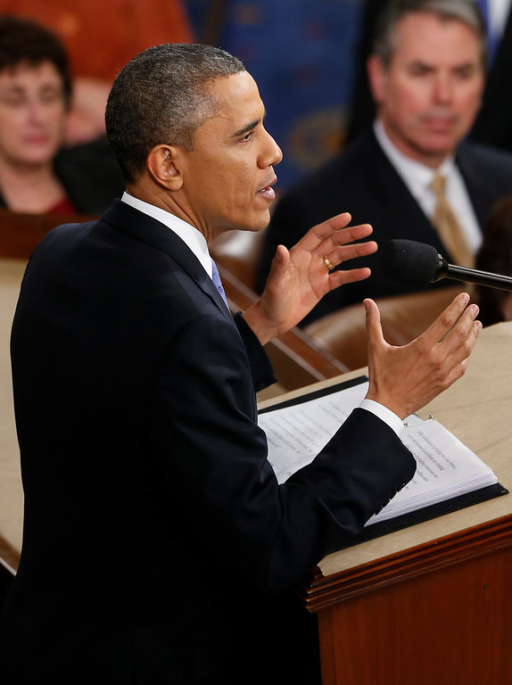 Description of . President Barack Obama gestures as he gives his State of the Union address during a joint session of Congress on Capitol Hill in Washington, Tuesday Feb. 12, 2013. (AP Photo/J. Scott Applewhite)
