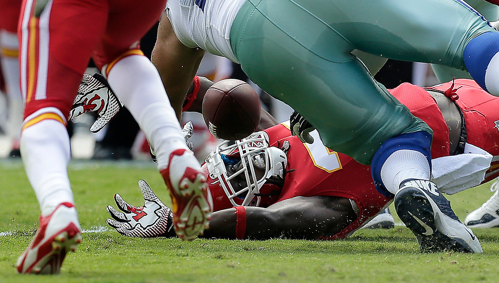 Description of . Kansas City Chiefs defensive back Ron Parker (38) grabs a fumble by Dallas Cowboys quarterback Tony Romo (9) during the second half of an NFL football game at Arrowhead Stadium in Kansas City, Mo., Sunday, Sept. 15, 2013. (AP Photo/Charlie Riedel)