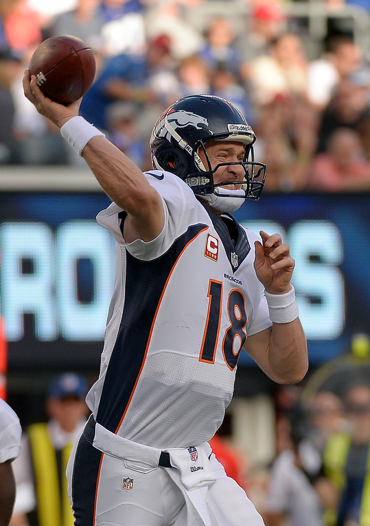 Description of . Denver Broncos quarterback Peyton Manning (18) throws a pass against the New York Giants during the second quarter September 15, 2013 MetLife Stadium. (Photo by John Leyba/The Denver Post)