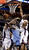 Denver Nuggets' Ty Lawson (3) splits the defense of Charlotte Bobcats' Jeffery Taylor, left and Bismack Biyombo to score during the second half of an NBA basketball game in Charlotte, N.C., Saturday, Feb. 23, 2013. The Nuggets won 113-99. (AP Photo/Bob Leverone)