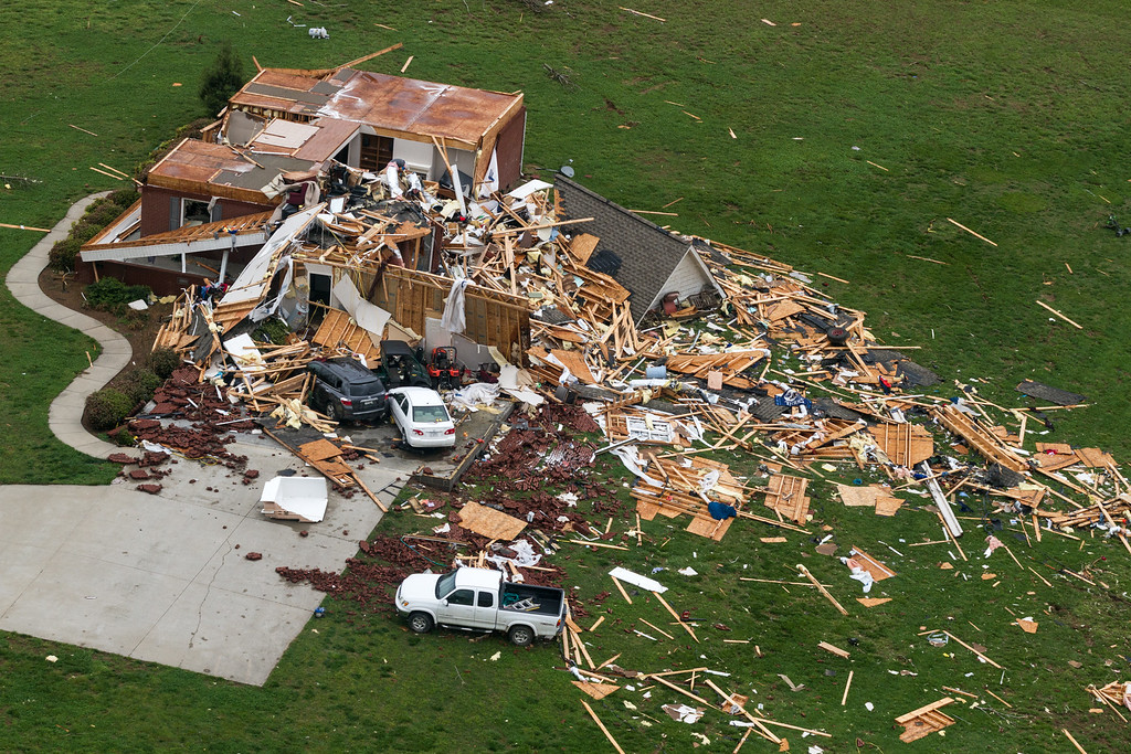 Description of . This aerial photo shows a home damaged by a tornado near Fayetteville, Tenn., on Wednesday, April 30, 2014. Gov. Bill Haslam visited the area near the Alabama line that suffered heavy damage and two fatalities during Monday's storms. (AP Photo/Erik Schelzig)