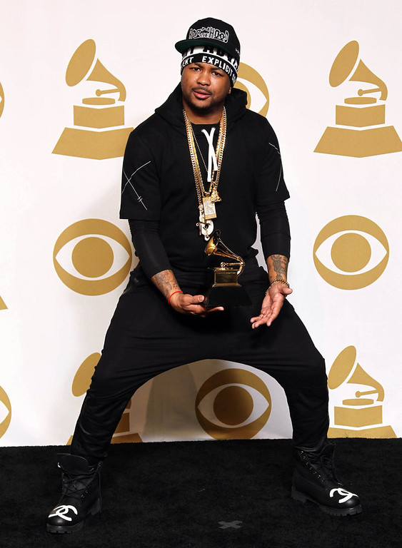 "Description of . The-Dream poses backstage with the awards for best rap/sung collaboration for ""No Church in the Wild\"" at the 55th annual Grammy Awards on Sunday, Feb. 10, 2013, in Los Angeles. (Photo by Matt Sayles/Invision/AP)"