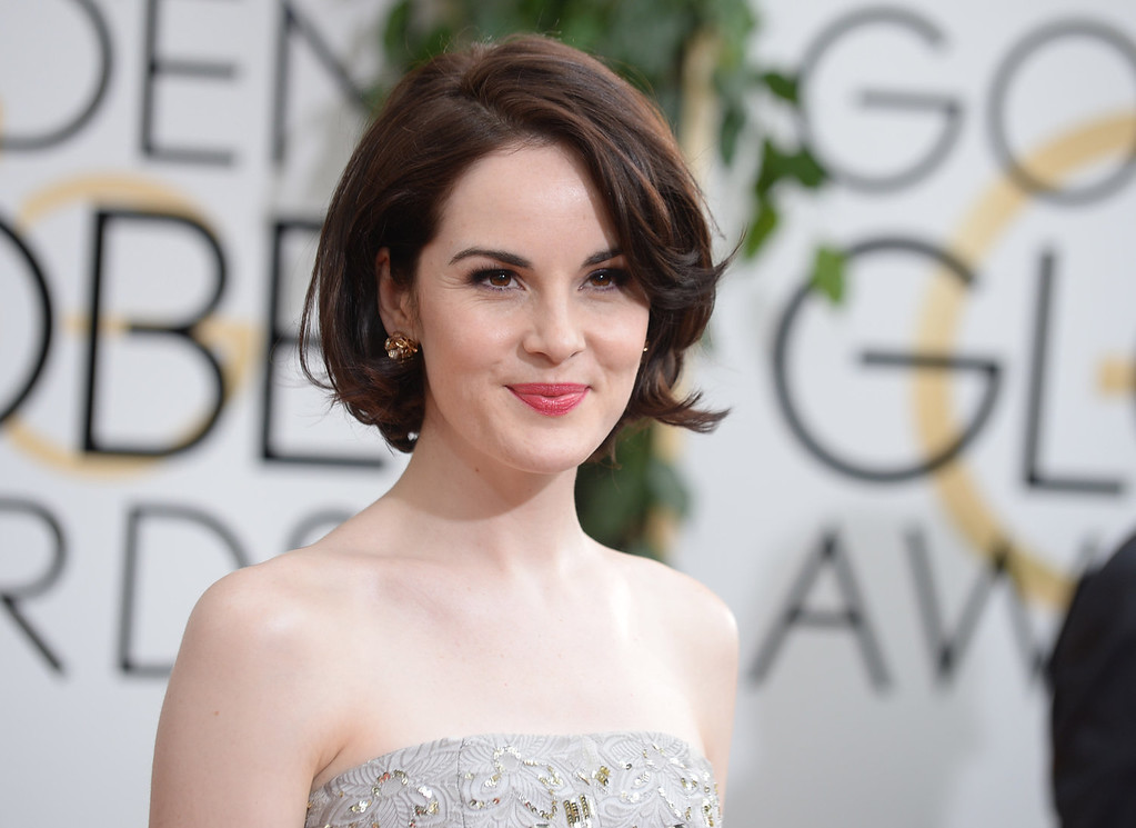 Description of . Michelle Dockery arrives at the 71st annual Golden Globe Awards at the Beverly Hilton Hotel on Sunday, Jan. 12, 2014, in Beverly Hills, Calif. (Photo by Jordan Strauss/Invision/AP)