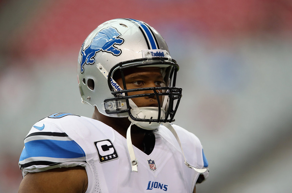 Description of . Defensive tackle Ndamukong Suh #90 of the Detroit Lions looks on prior to the start of the game against the Arizona Cardinals at University of Phoenix Stadium on September 15, 2013 in Glendale, Arizona.  (Photo by Jeff Gross/Getty Images)