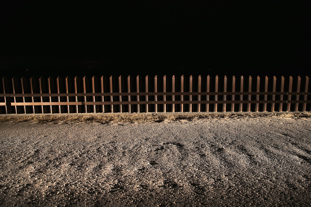 Description of . MCALLEN, TX - APRIL 10:  A section of the U.S.- Mexico border fence stands on April 10, 2013 in La Joya, Texas. According to the Border Patrol, undocumented immigrant crossings have increased more than 50 percent in Texas\' Rio Grande Valley sector in the last year. Border Patrol agents say they have also seen an additional surge in immigrant traffic since immigration reform negotiations began this year in Washington D.C. Proposed refoms could provide a path to citizenship for many of the estimated 11 million undocumented workers living in the United States.  (Photo by John Moore/Getty Images)